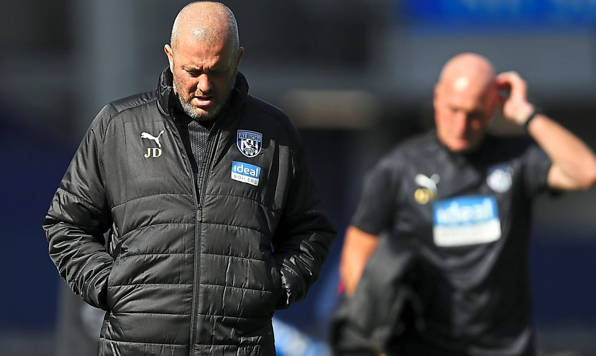 A dejected Julian Dicks first team coach of West Bromwich Albion  leaves the pitch at the end of the game after losing 5-2.