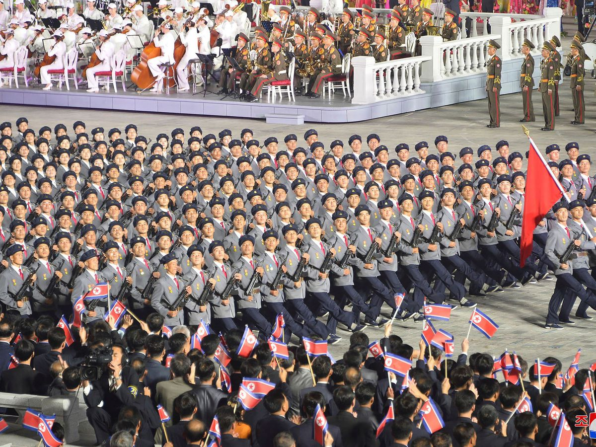 North Korean troops parade during a celebration of the nation's 73rd anniversary that was overseen by leader Kim Jong Un (AP)