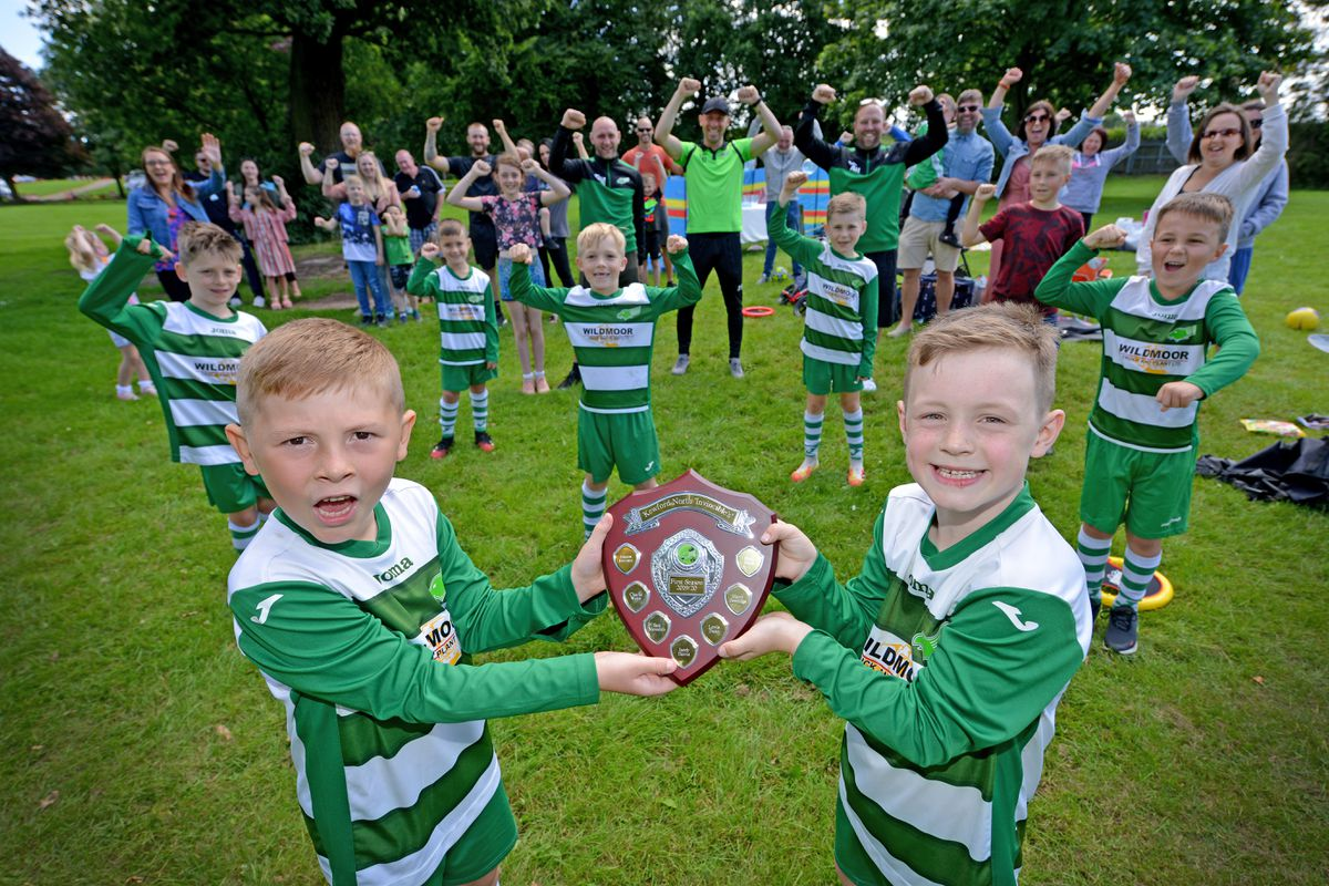 Kewford Eagles under 7s have gone unbeaten in their first season. Left, Mason Downes and Sam Meredith with the team.