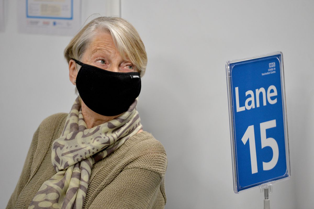 Mass vaccination centre opens at Millennium Point, Birmingham. Pictured, Rita Passey gets the jab.