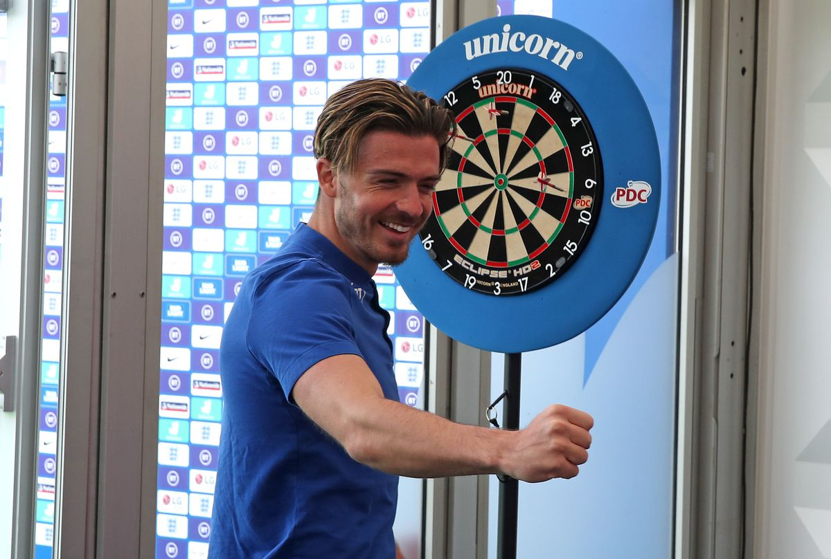 A relaxed Jack Grealish celebrates after playing darts in England's training camp on Wednesday.