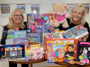 WALSALL COPYRIGHT EXPRESS&STAR TIM THURSFIELD-27/11/20.Anchor Estates, Aldridge are collecting for the Children's Ward at Walsall Manor Hospital for those children who will have to spend the festive period away from home. They are looking to provide new children's toys to help make their time in hospital more bearable during the festive season. Pictured are Lorraine Busby and Debbie Dyer from Anchor Estates with some of the toys already collected..