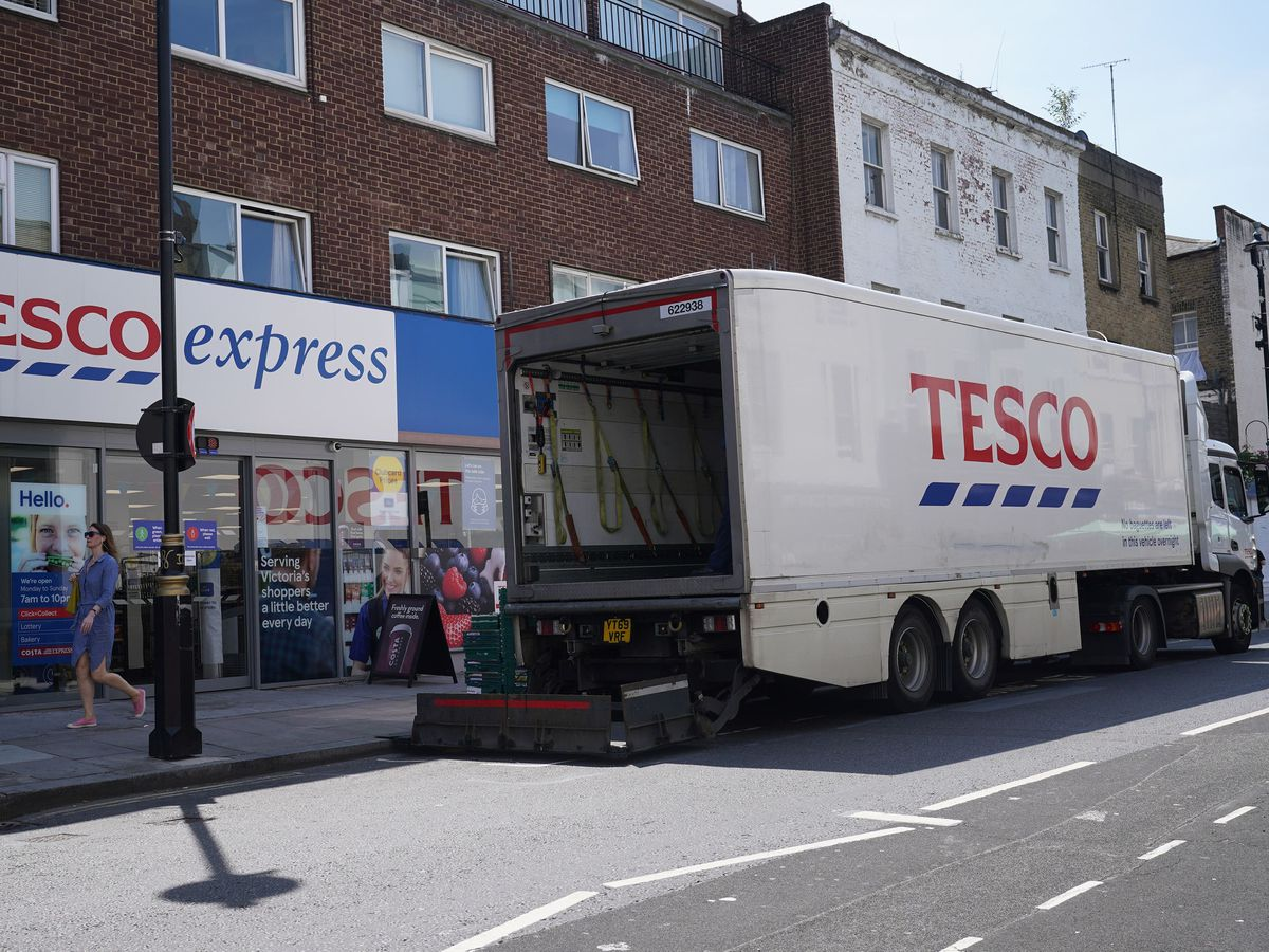 A delivery lorry outside a Tesco Express store in central London.