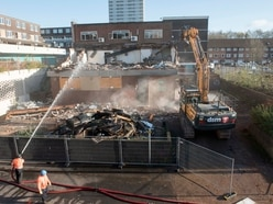Piles of debris on the skyline in Heath Town as redevelopment continues