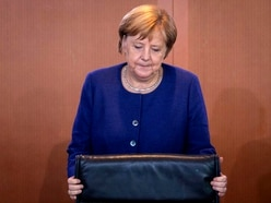 Merkel under pressure as ally ousted from key post