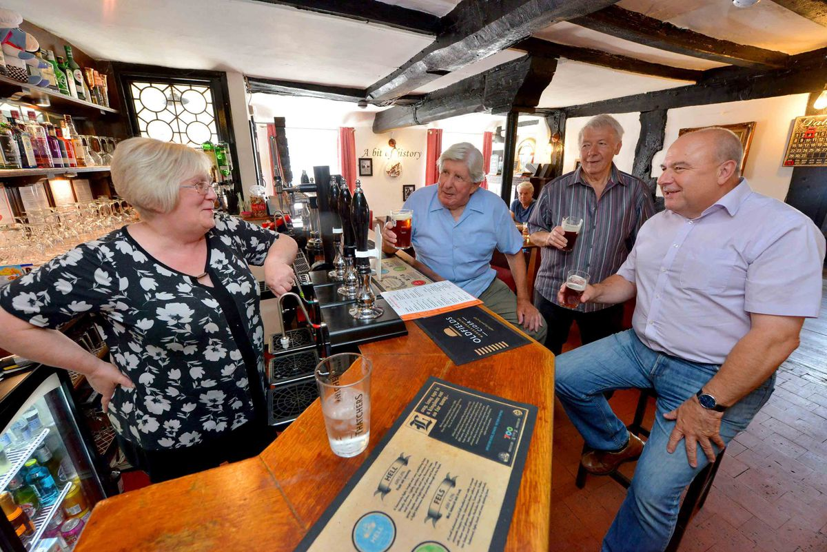 Mary Lavender with customers at The Crown in Claverley