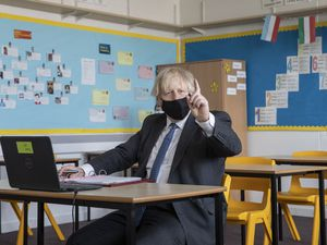 Prime Minister Boris Johnson takes part in an online class during a visit to Sedgehill School in Lewisham, south east London, to see preparations for students returning to school. Picture date: Tuesday February 23, 2021. PA Photo. See PA story HEALTH Coronavirus. Photo credit should read: Jack Hill/The Times/PA Wire.