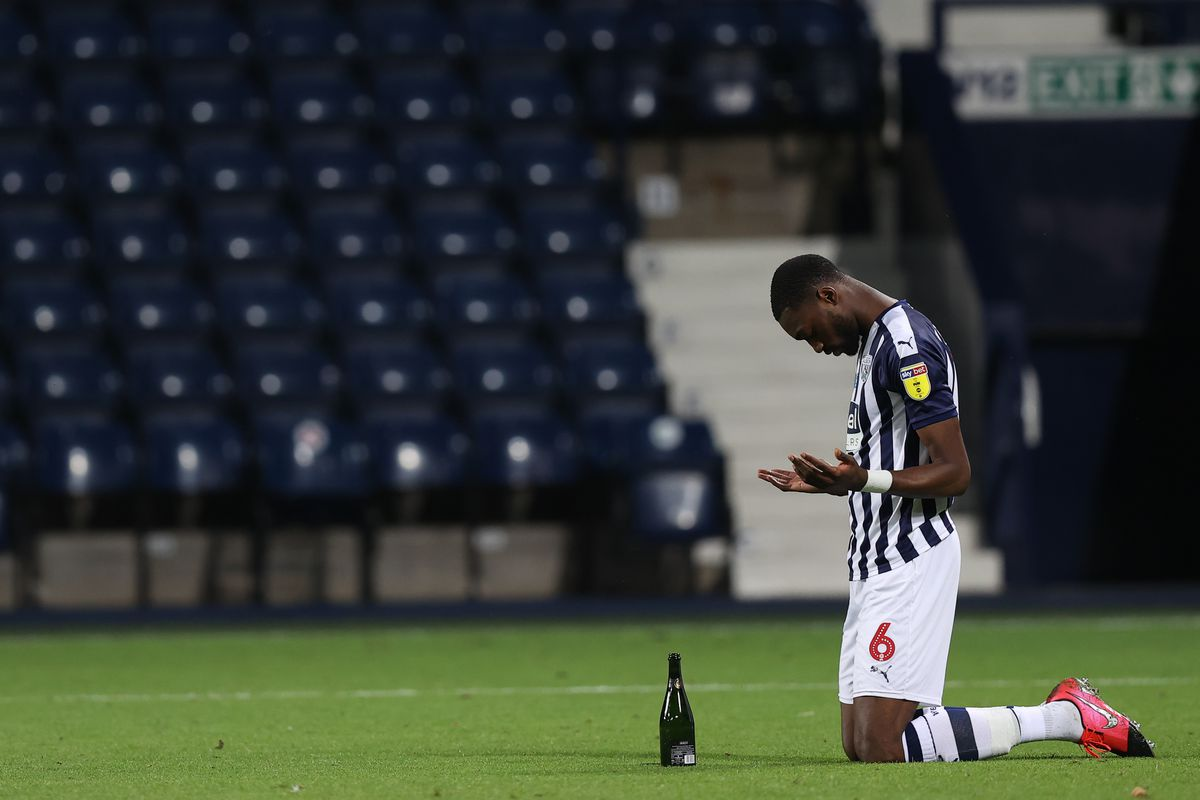 Semi Ajayi of West Bromwich Albion prays at full time as promotion is confirmed. (AMA)