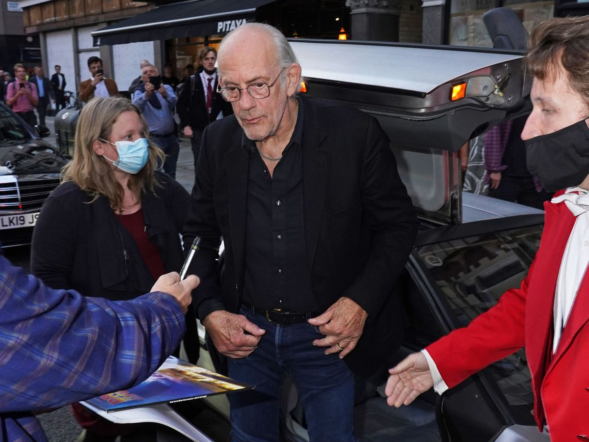 Christopher Lloyd steps out of a DeLorean