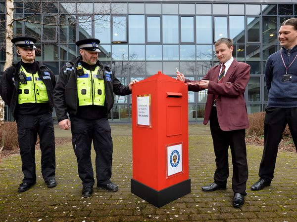 Students at RSA Academy in Tipton have made a make shift postbox for the police. PCSO's Emerson Dunne and George Lewis, student Kieron Unitt and DT technician Jamie Quinn