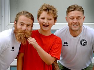 Leo Garratt  with bearded midfielder Stuart Sinclair and Walsall captain James Clarke, who surprised him at his school assembly