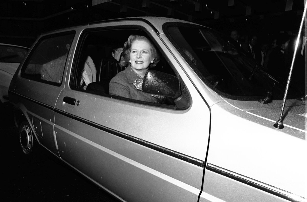 Prime Minister Margaret Thatcher drives one of the first Mini Metros into the National Exhibition Centre, Birmingham, to officially open the 1980 Motor Show