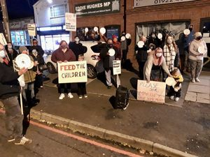 Protesters gathered outside Walsall North MP Eddie Hughes\' constituency office. Photo: Ursula Walker