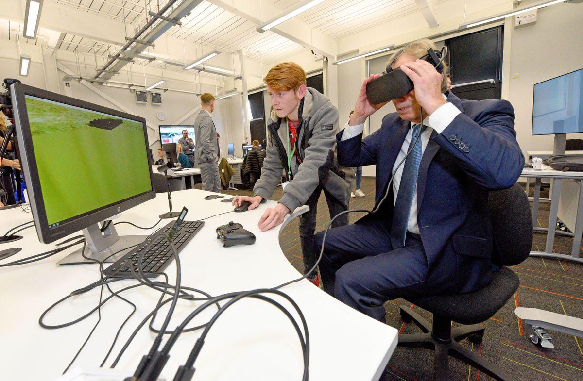 Trying on a VR headset at Dudley College