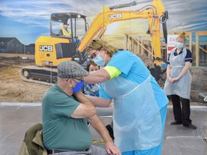 Ron Carnwell receives the Covid vaccine at JCB in Cheadle