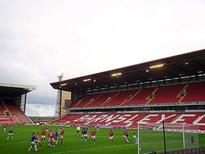 Empty stands as Bristol City have a shot at goal during the Sky Bet Championship match at Oakwell, Barnsley