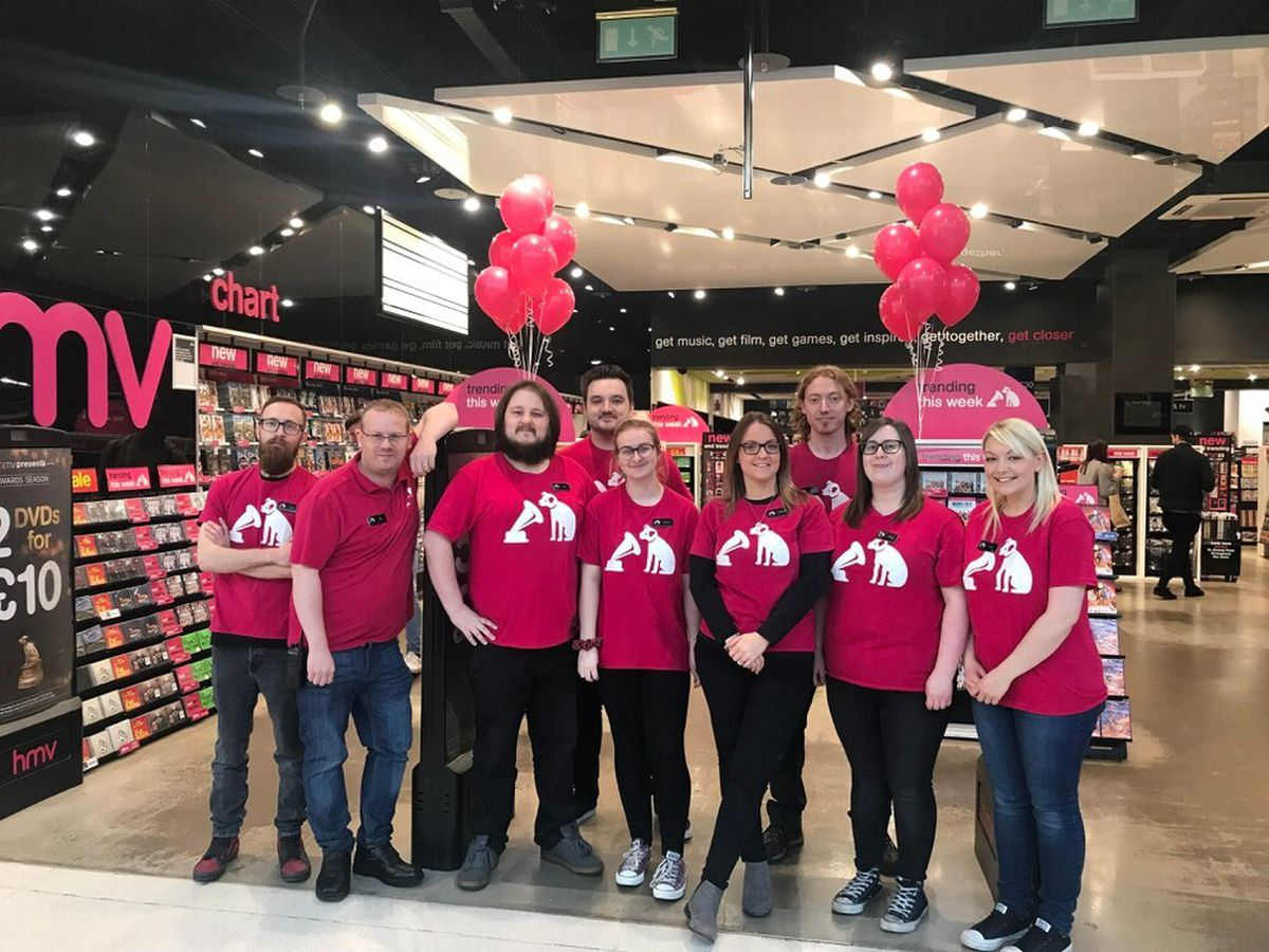 Staff celebrate the reopening of HMV Merry Hill in February