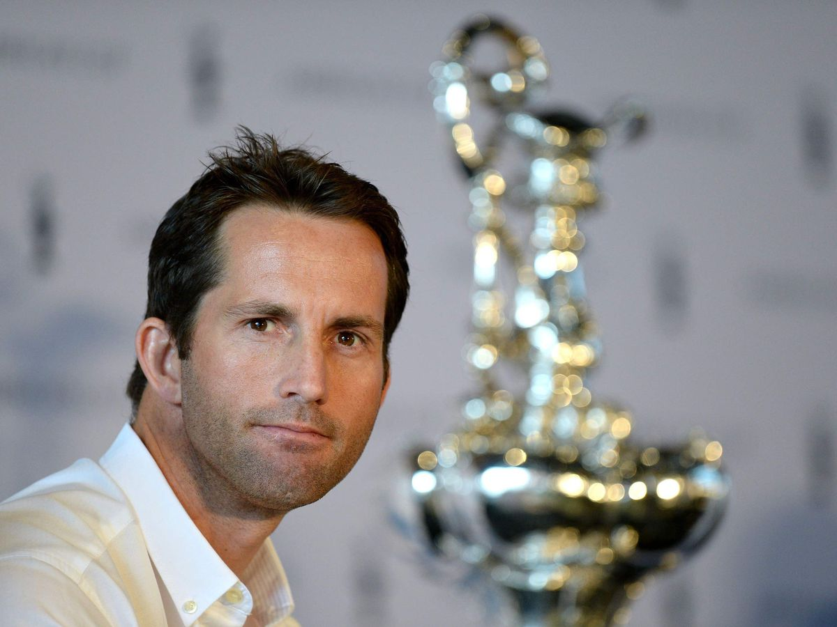 Sir Ben Ainslie next to the America's Cup