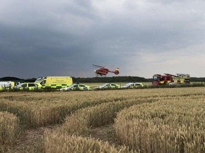 Man freed by fire crews after plane crashes in field