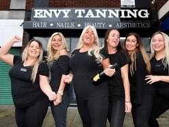 Sunbed shop gutted by fire reopens