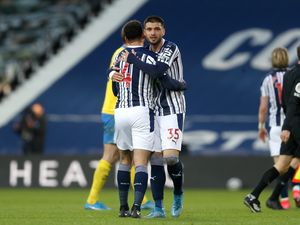 Okay Yokuslu of West Bromwich Albion celebrates the 1-0 win with Hal Robson-Kanu of West Bromwich Albion.