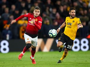 Andreas Pereira of Manchester United and Joao Moutinho of Wolverhampton Wanderers (AMA)