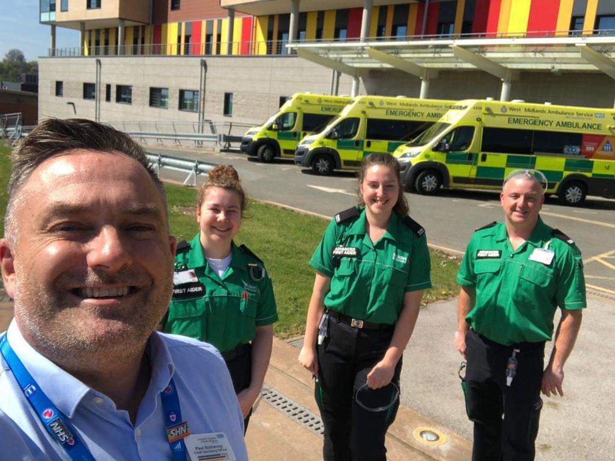 Paul Bytheway, chief operating officer at University Hospitals of North Midlands, with St John volunteers Erin Sohnrey, Megan Dunton and Mick Storr