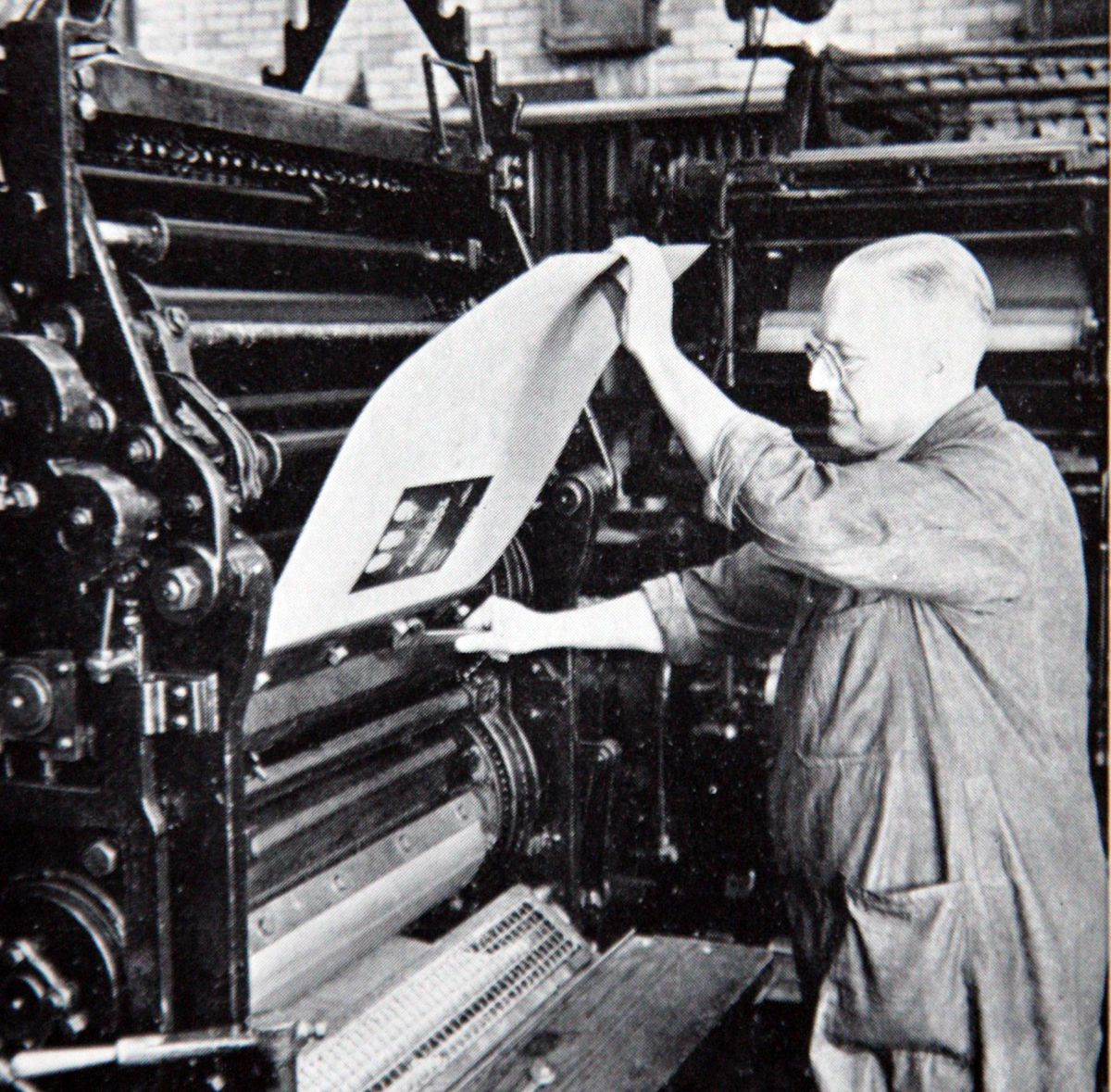 A man works at the printing press