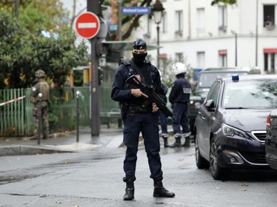 Seven in custody after stabbing linked to Charlie Hebdo