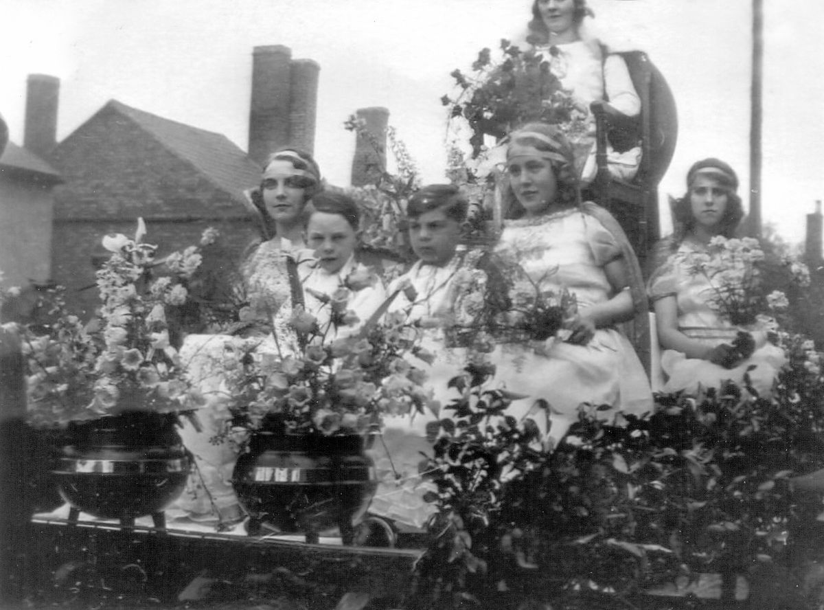 Teenage Ellen Taylor, left, as an attendant to carnival queen Gladys Price at the 1930 Lye carnival