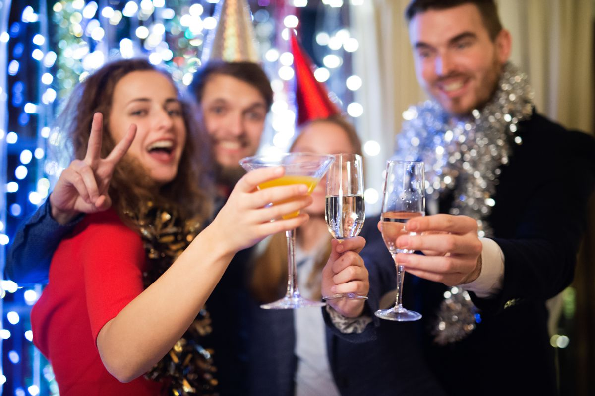 Group of friends celebrating the end of the year, having party on New Years Eve