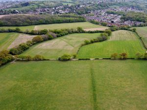 An aerial photograph, taken by Express & Star photographer Tim Thursfield, showing the green rolling fields of the Seven Cornfields, Wolverhampton, where a housing development is proposed. In the background is Sedgley, in the north of neighbouring borough Dudley.