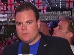 World Cup reporter continues live show after fan throws beer in his face
