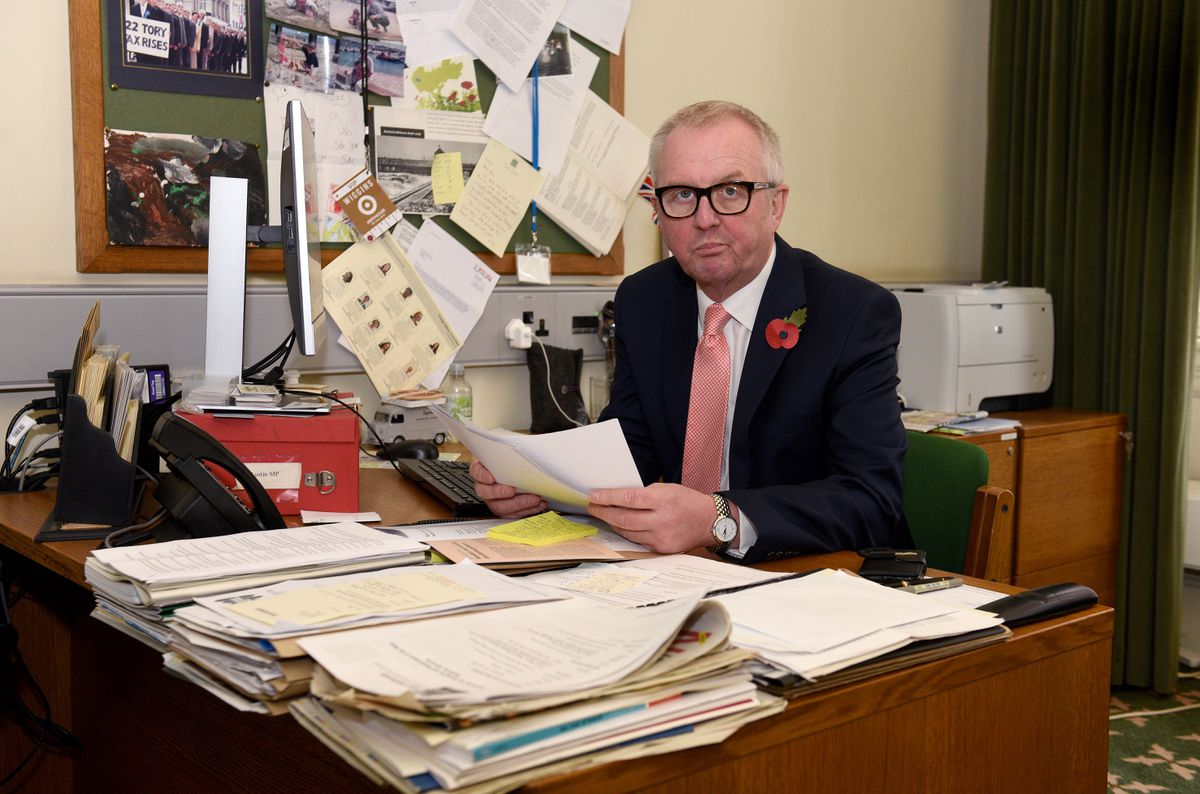 Mr Austin in his Westminster office, which he will now be vacating