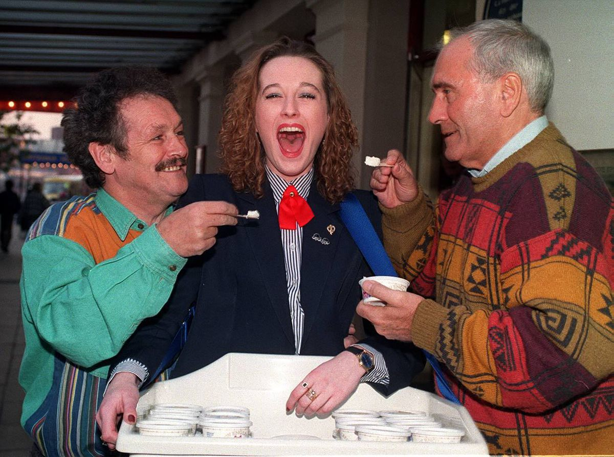 Bobby Ball, left, and Tommy Cannon, right, give 21-year-old usherette Kate Hallmark a taste of her own ice cream at Wolverhampton Grand Theatre