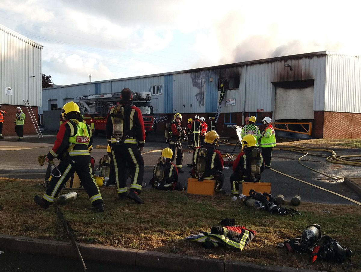 Crews at the scene of the factory blaze. Picture: Paul Hansel