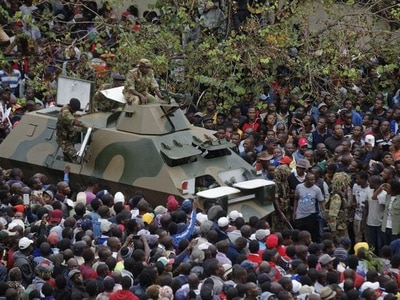 Zimbabweans call for Mugabe to quit now, but more talks planned