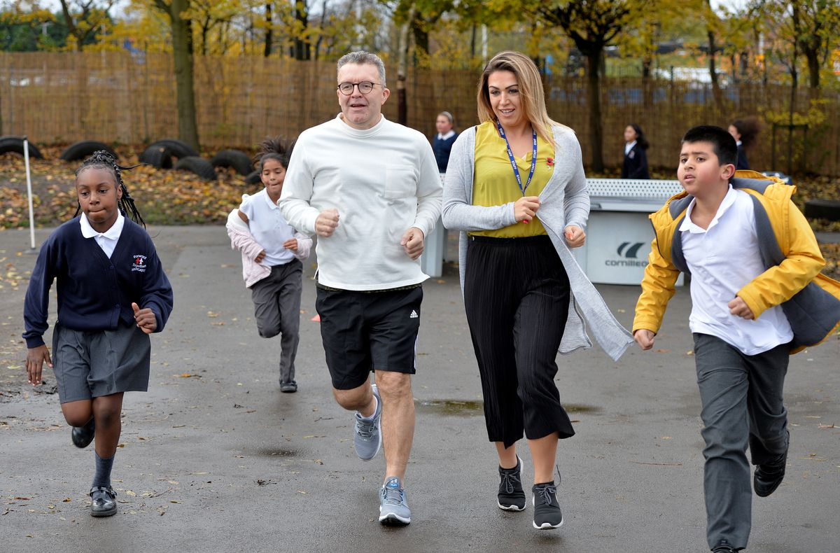 Tom Watson joined pupils and staff in taking part