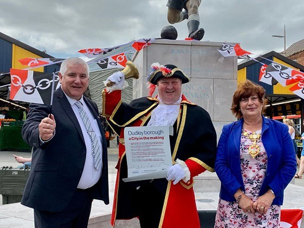 Councillor Patrick Harley, leader of Dudley Council with town crier Ian Jones and the Mayor of Dudley, Councillor Anne Millward