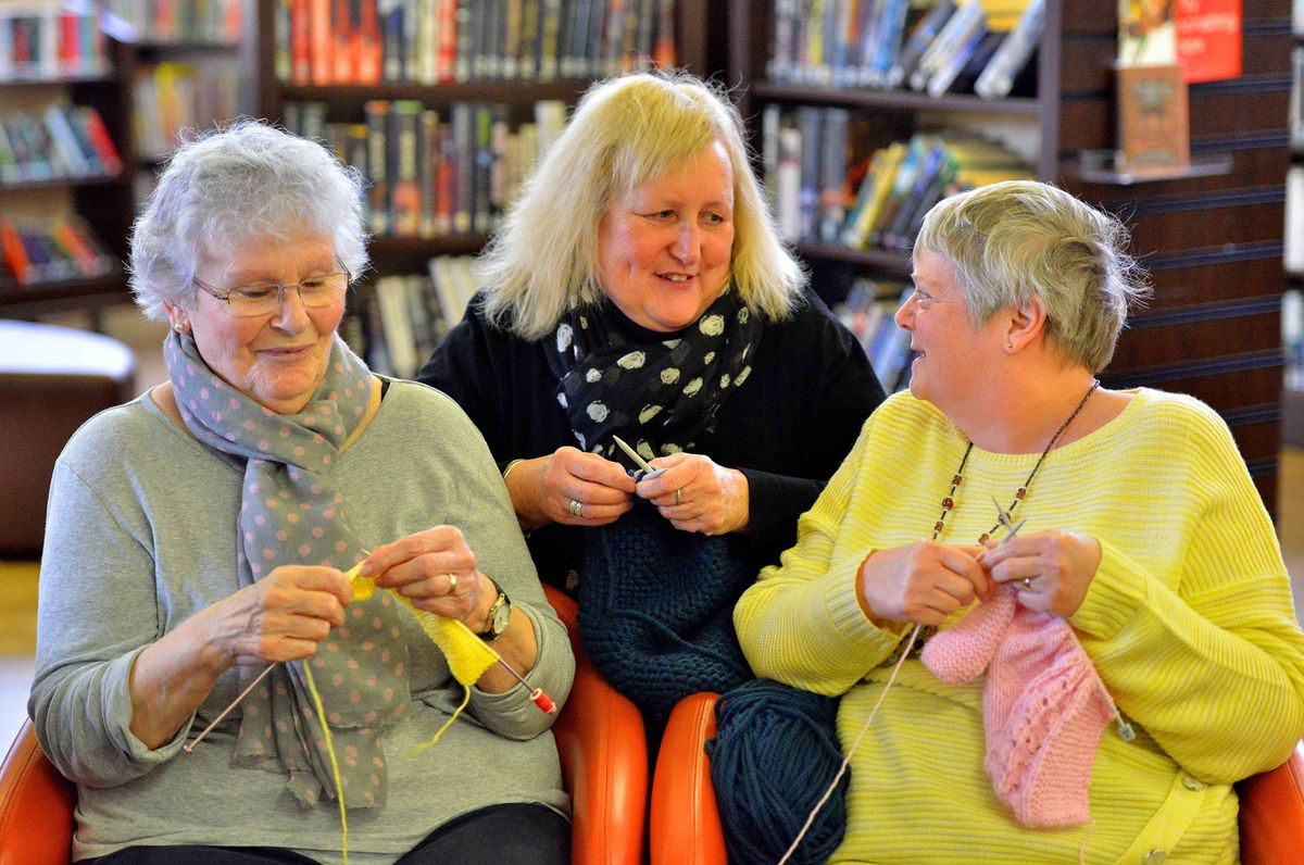 Julie McKirdy with Knit & Natter group members Bruna Kelly and Susan Hammond