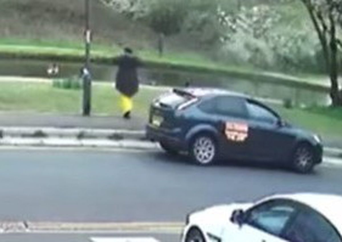 A screenshot from CCTV posted on Facebook showing a person next to the taxi and the lamp post with the ribbon on