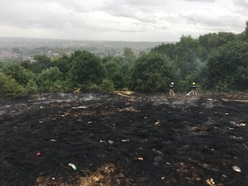 Firefighters tackle large grass fire in Rugeley