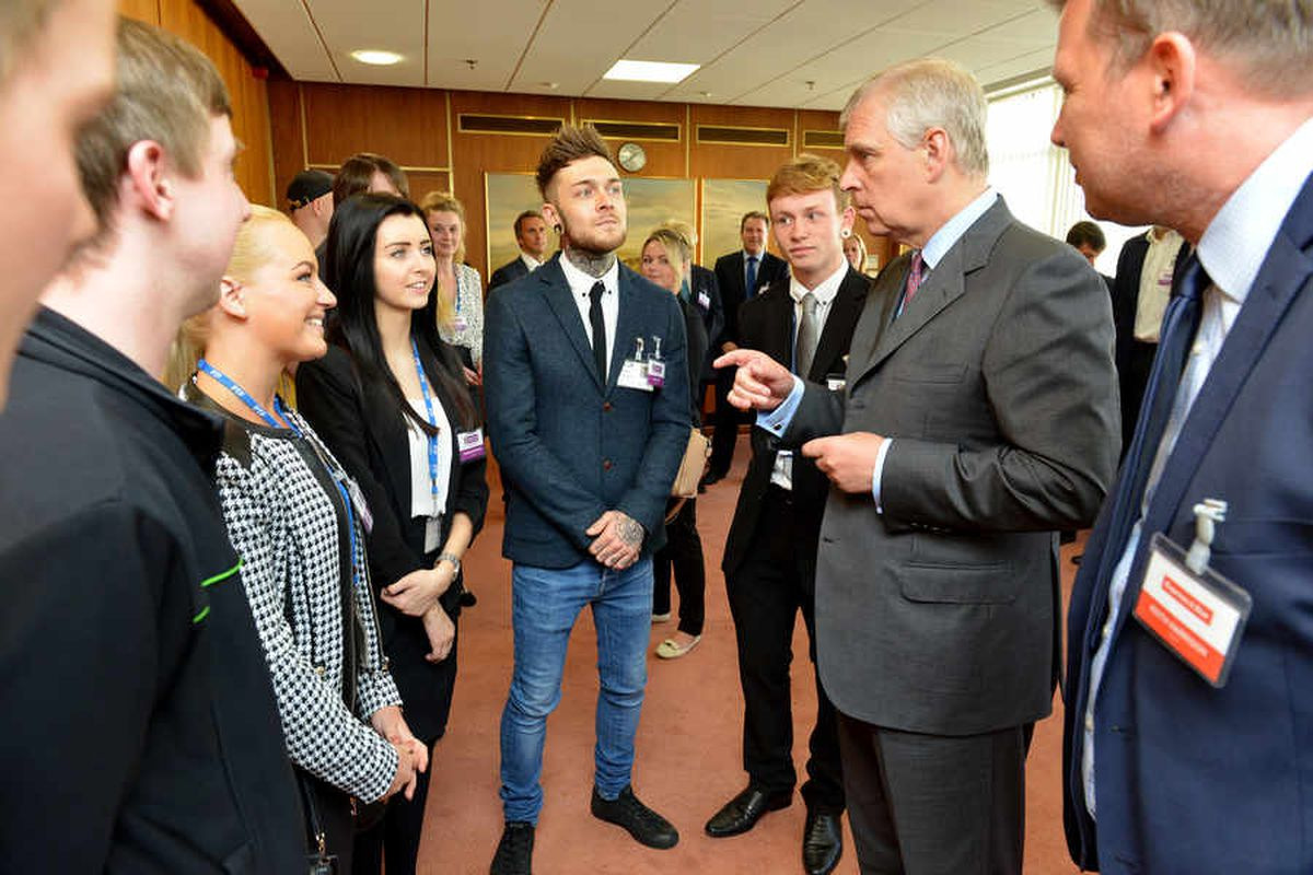 HRH The Duke of York Prince Andrew chatting with apprentices on a visit to the Express & Star