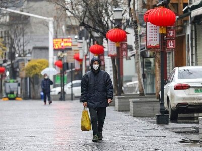 Virus death toll in China rises to 56 with almost 2,000 cases