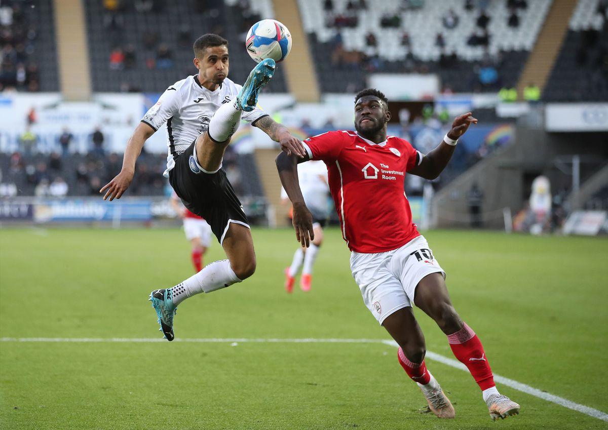 Swansea City's Kyle Naughton (left) and Barnsley's Daryl Dike