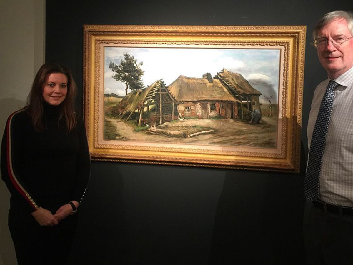James Roundell and Emma Ward, from Dickinson's, with Van Gogh's Peasant Woman in front of a Farmhouse. Photo: Martin Bailey