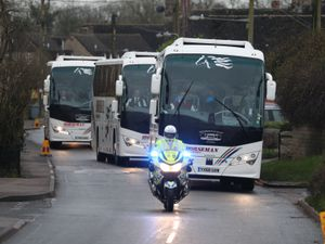 Coaches under police escort leave Brize Norton, Oxfordshire, carrying passengers from a plane which transported British nationals from the coronavirus-hit city of Wuhan in China. PA Photo. Picture date: Friday January 31, 2020. See PA story HEALTH Coronavirus. Photo credit should read: Andrew Matthews/PA Wire