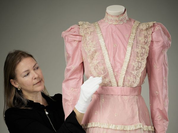 The pink satin dress with lace overlay worn by Princess Elizabeth to play Lady Christina Sherwood in Old Mother Red Riding Boots in 1944