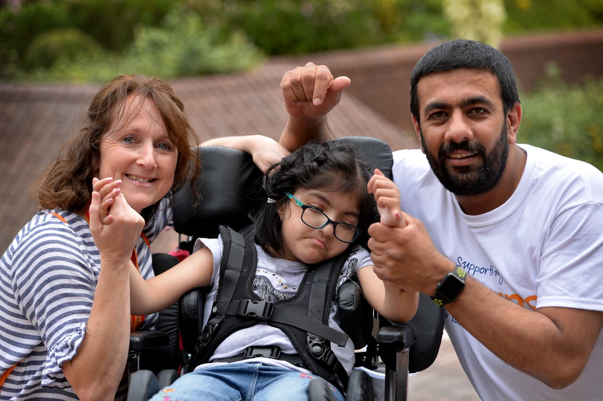 Hospice at home nurse Wendy Porter, Amjid Mehmood and his daughter Zara Khan who rely on the service.