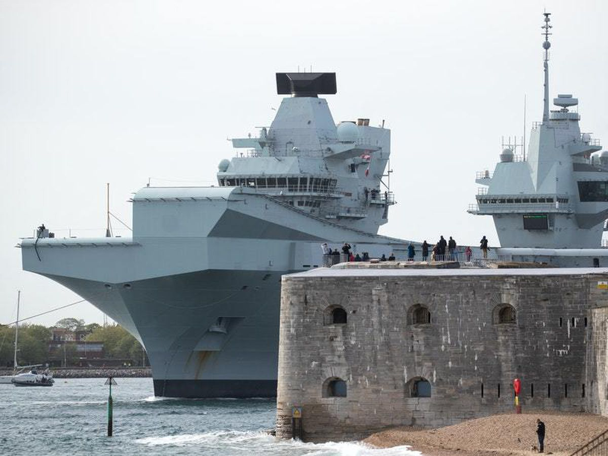 The Royal Navy aircraft carrier HMS Queen Elizabeth leaves Portsmouth harbour after being delayed due to the crew being tested for coronavirus